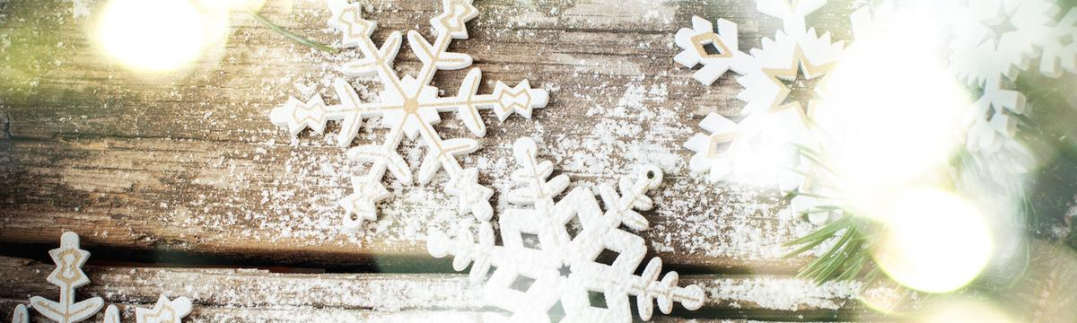Holiday Background with Bright Glow and White Wooden Decorative Snowflakes